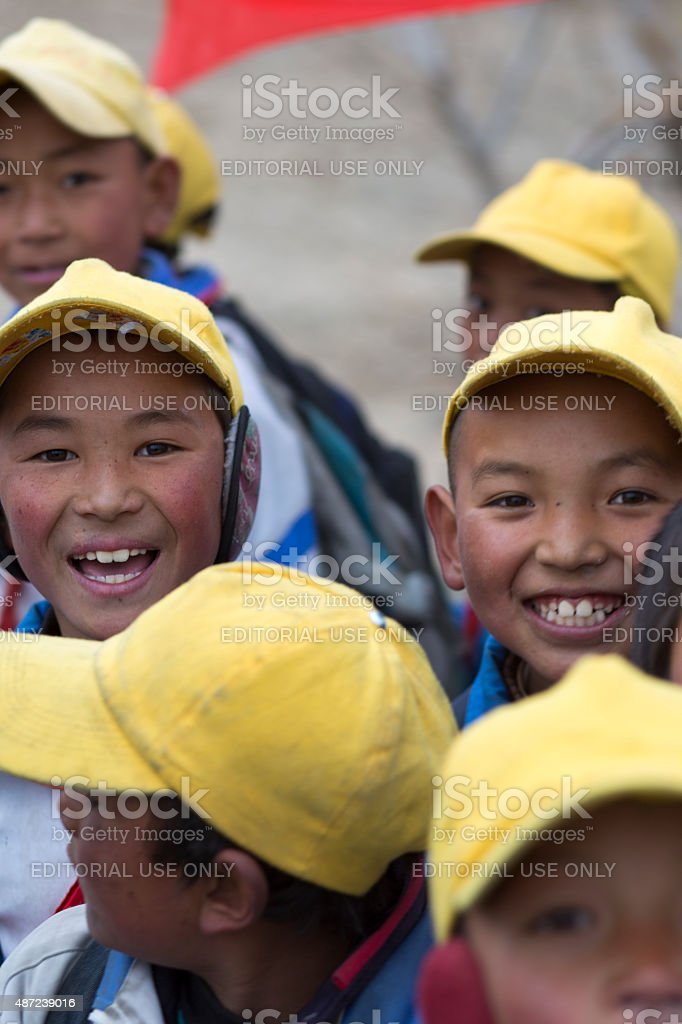 Kids playing with a red flag in Tibet stock photo