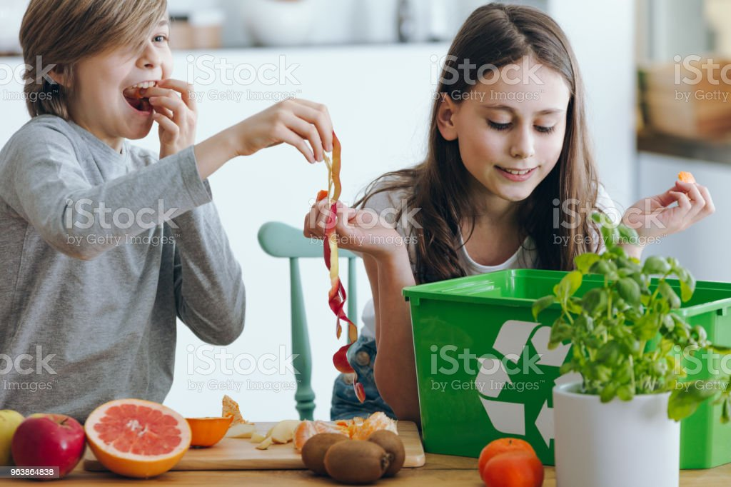 Kids playing with apple skin - Royalty-free Alertness Stock Photo