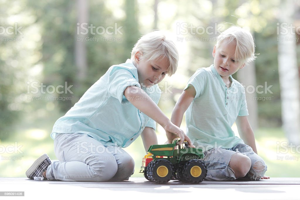 Kids playing with cars royalty-free stock photo