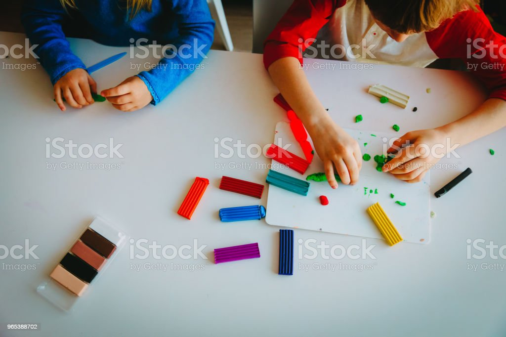 kids playing with clay molding shapes royalty-free stock photo