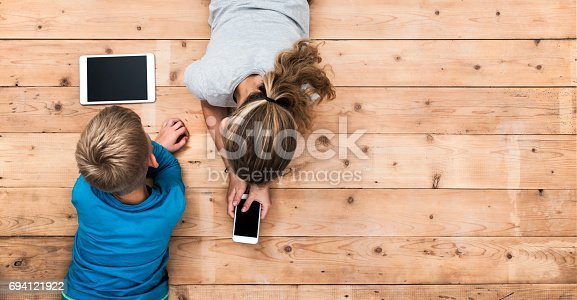 istock Kids playing with mobile devices header 694121922