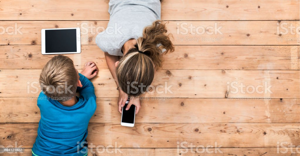 Kids playing with mobile devices header stock photo