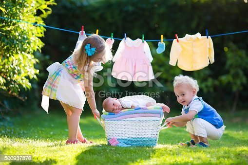 954356678istockphoto Kids playing with newborn baby brother 500937876