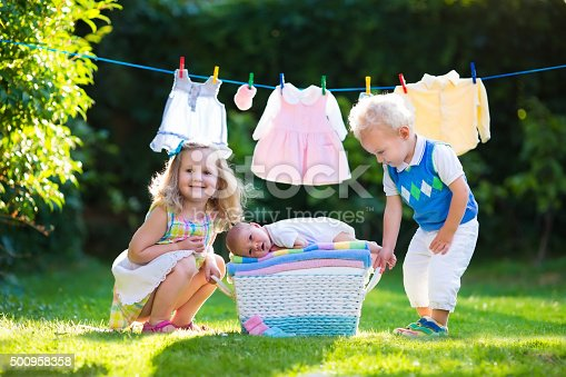 954356678istockphoto Kids playing with newborn baby brother 500958358