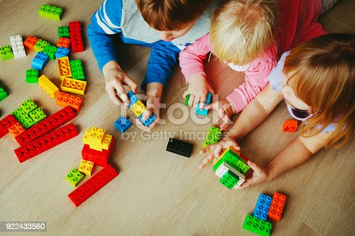 istock kids playing with plastic blocks, learning concept 922433560