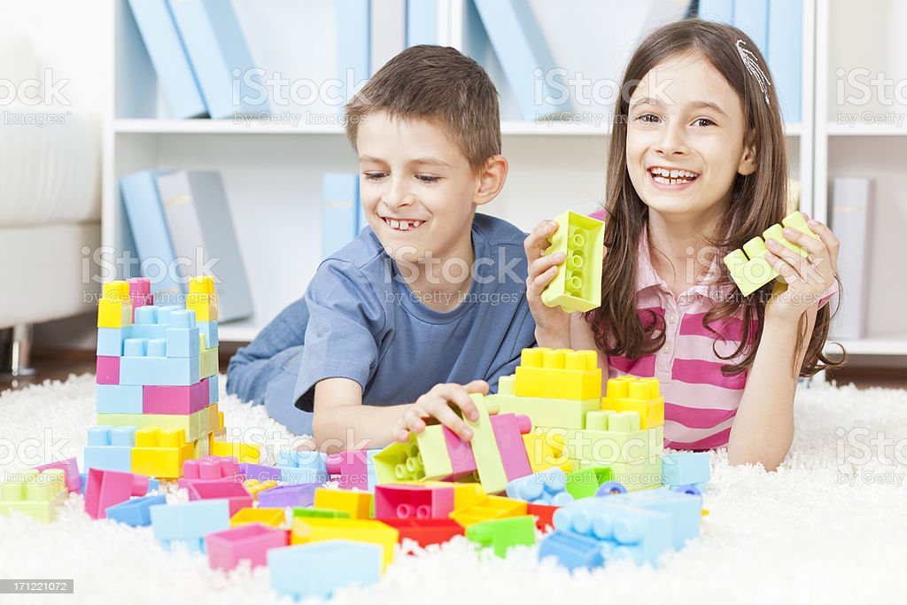 Kids playing with plastic blocks royalty-free stock photo