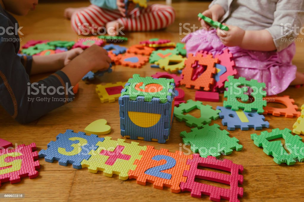 kids playing with puzzle, education concept stock photo