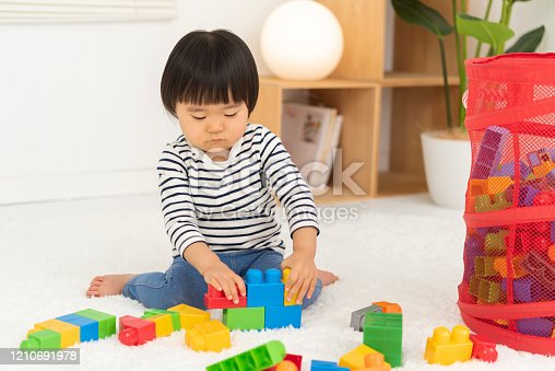 452592895 istock photo Kids playing with toy blocks, 2 year old girl 1210691978