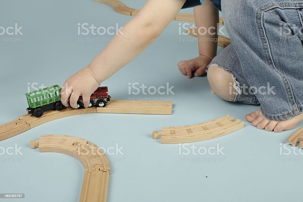 Kids playing with toy trains royalty-free stock photo