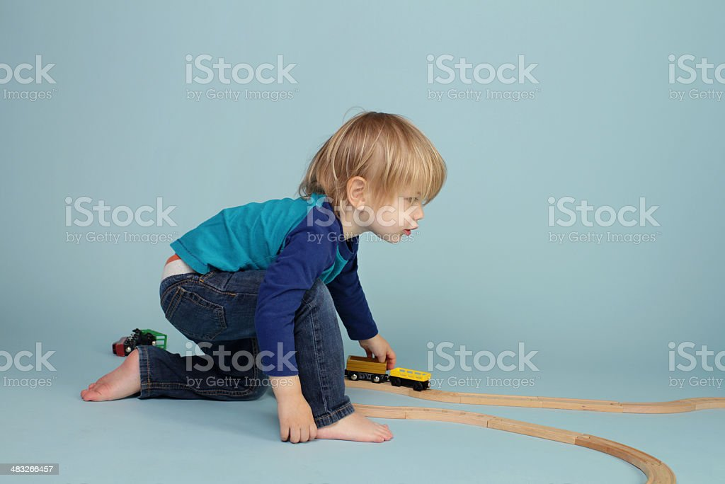 Kids playing with toy trains stock photo