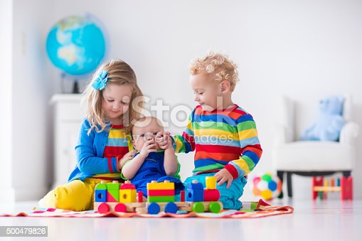 istock Kids playing with wooden toy train 500479826