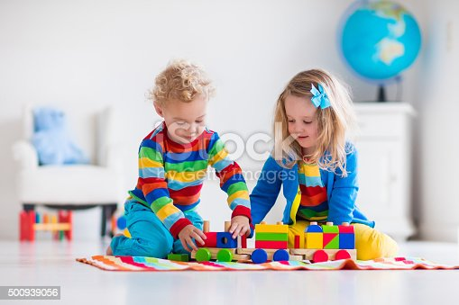 istock Kids playing with wooden toy train 500939056