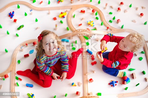 istock Kids playing with wooden train set 496663402