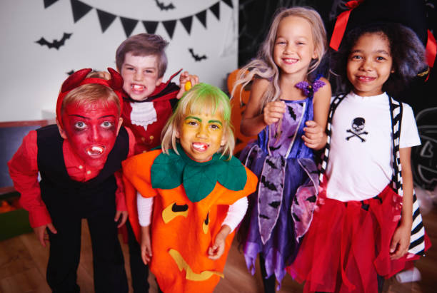 Kids posing  in halloween costume Kids posing  in halloween costume costume stock pictures, royalty-free photos & images