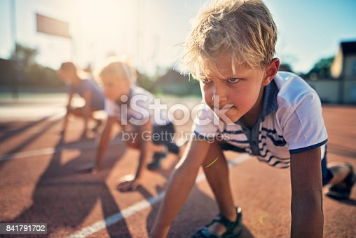 istock Kids preparing for track run race 841791702