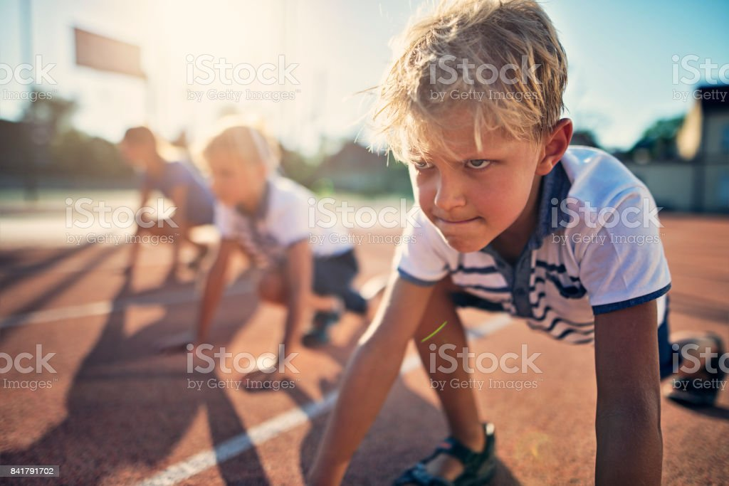 Kids preparing for track run race stock photo