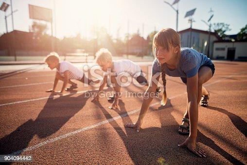 istock Kids preparing for track run race 904094442
