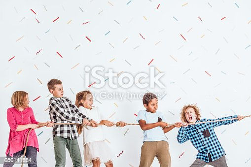 istock Kids pulling a rope 656141884