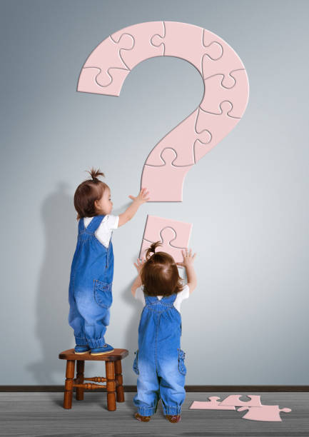 Kids question concept. Little childrens made question mark stock photo