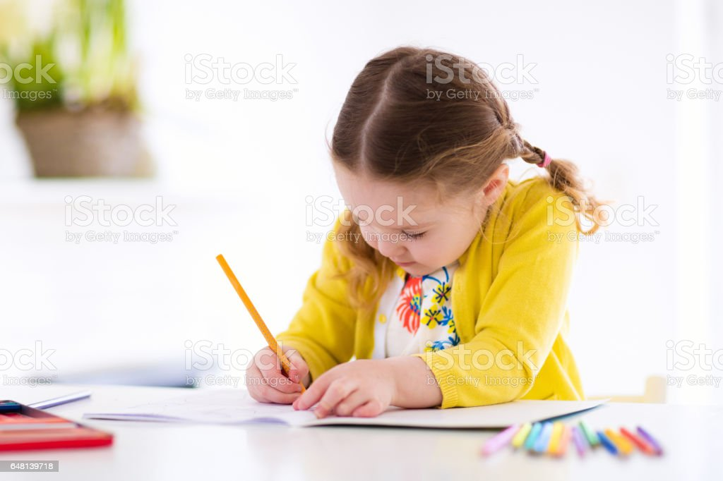 Kids read, write and paint. Child doing homework. stock photo