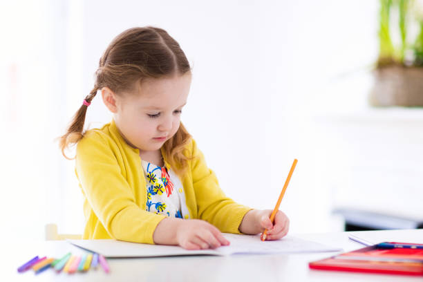 kids read, write and paint. child doing homework. - mädchen malen stock-fotos und bilder