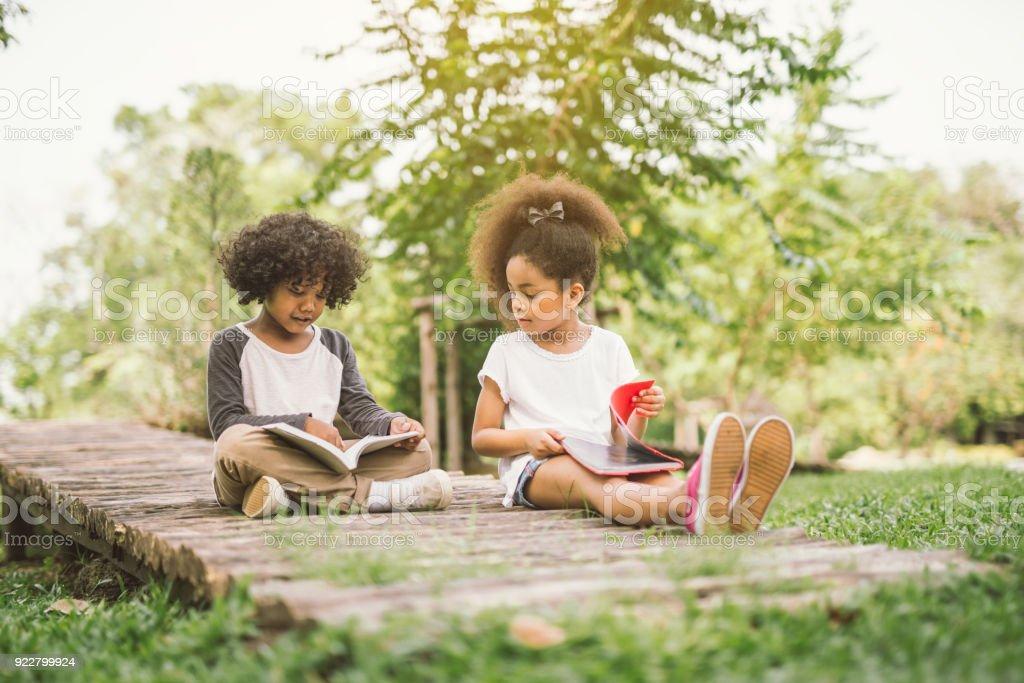 kids reading book stock photo