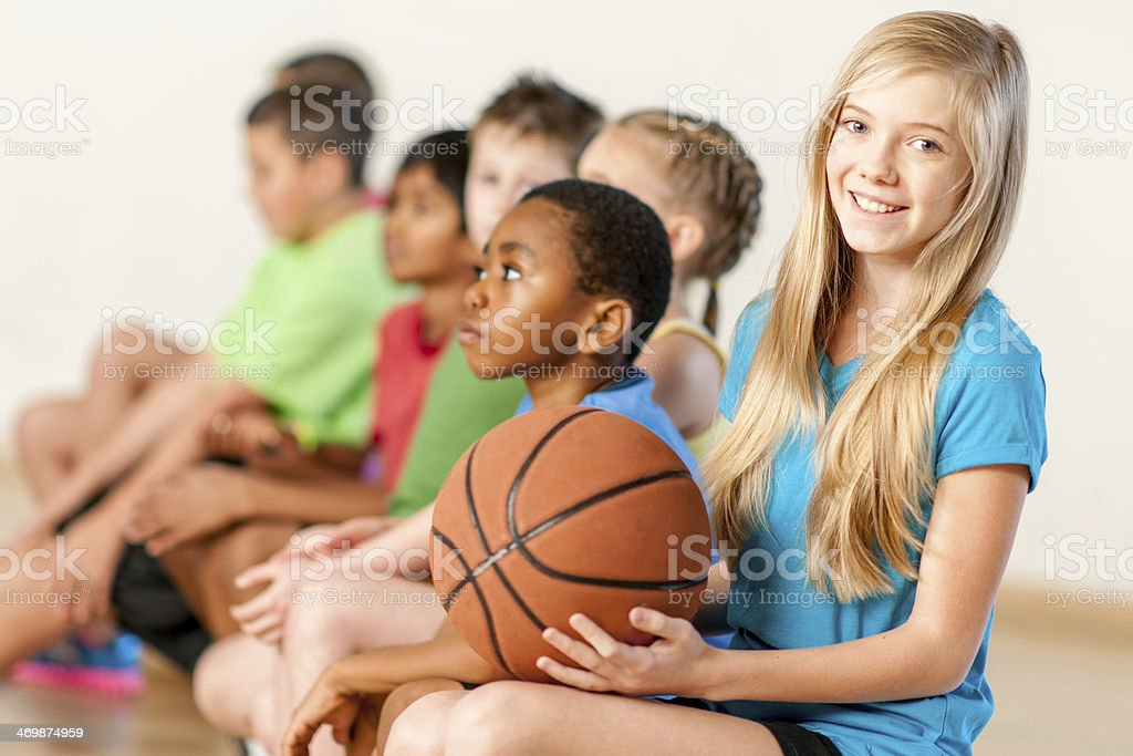 Kids resting after basketball training royalty-free stock photo