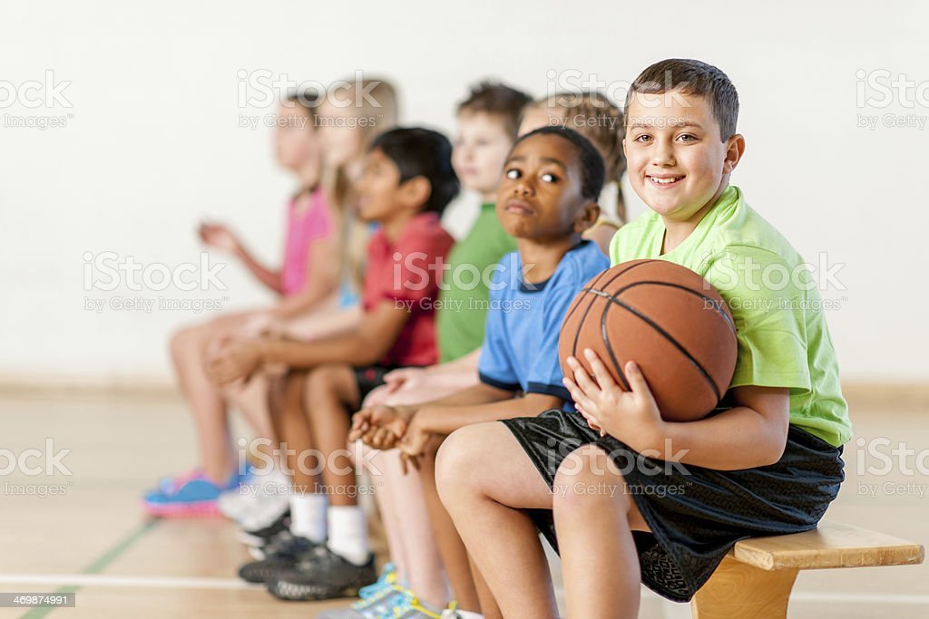 A group of kids having a rest after basketball training