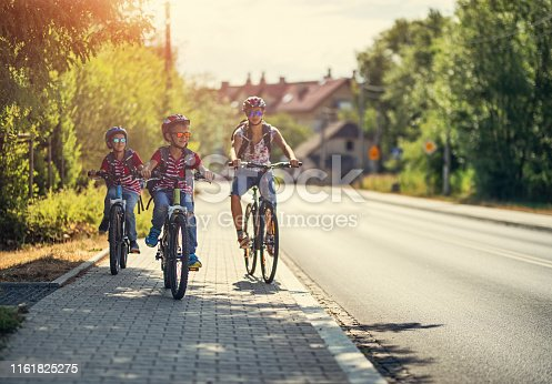 Three kids riding bikes to school. Nikon D850