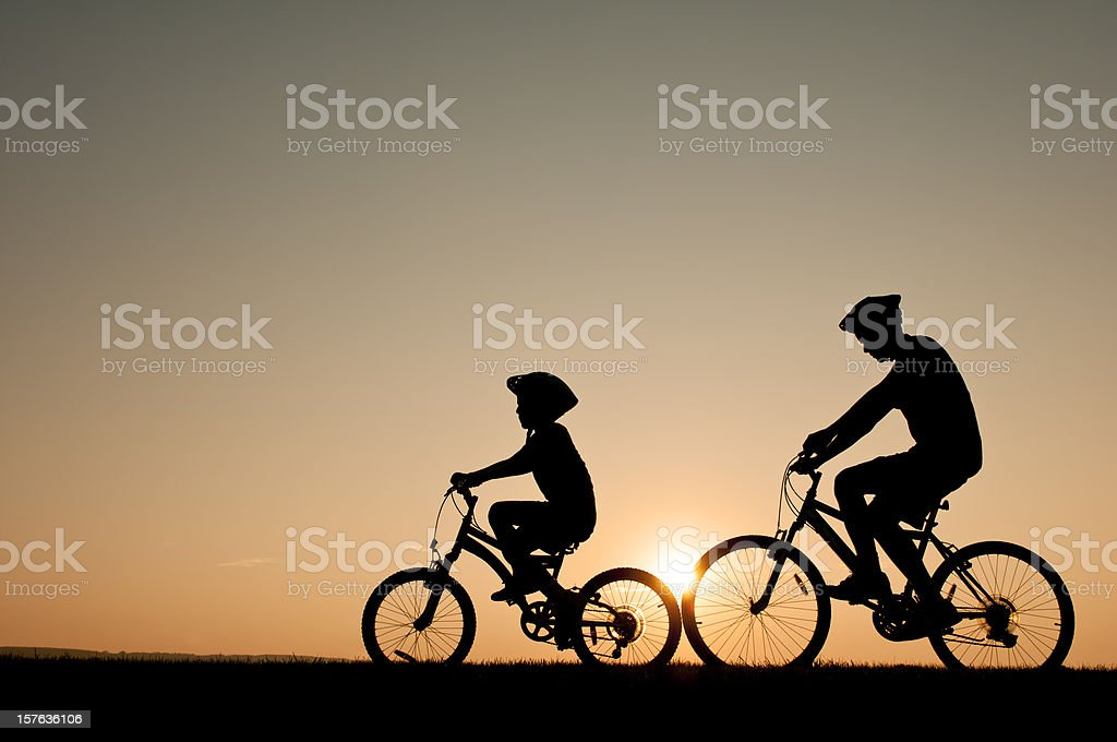 Kids riding their bikes during a summer evening - I royalty-free stock photo