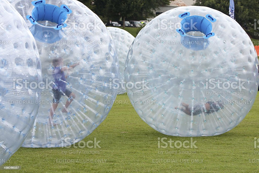 Kids Roll Around In Large Zorbs At Summer Festival stock photo