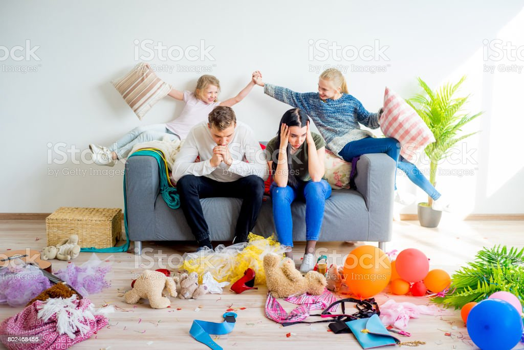 Kids romping at home stock photo