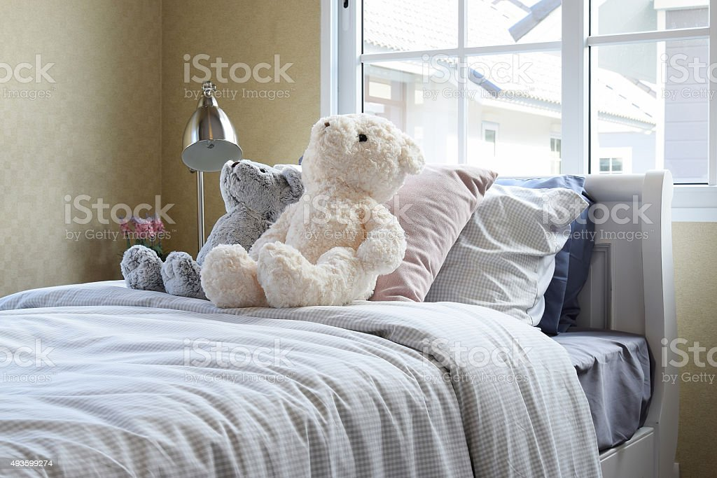 kids room with dolls and pillows on bed stock photo