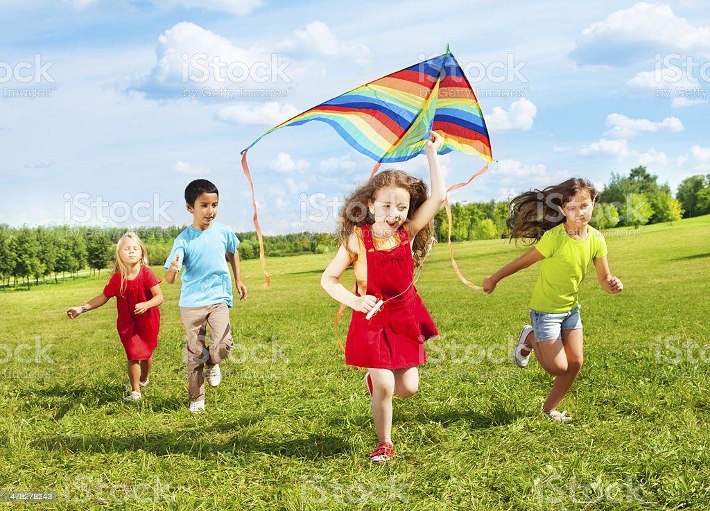 Kids run with kite stock photo