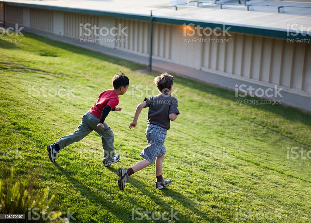 Kids Running Down The Hill royalty-free stock photo