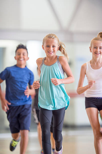 Kids Running During Gym Class stock photo