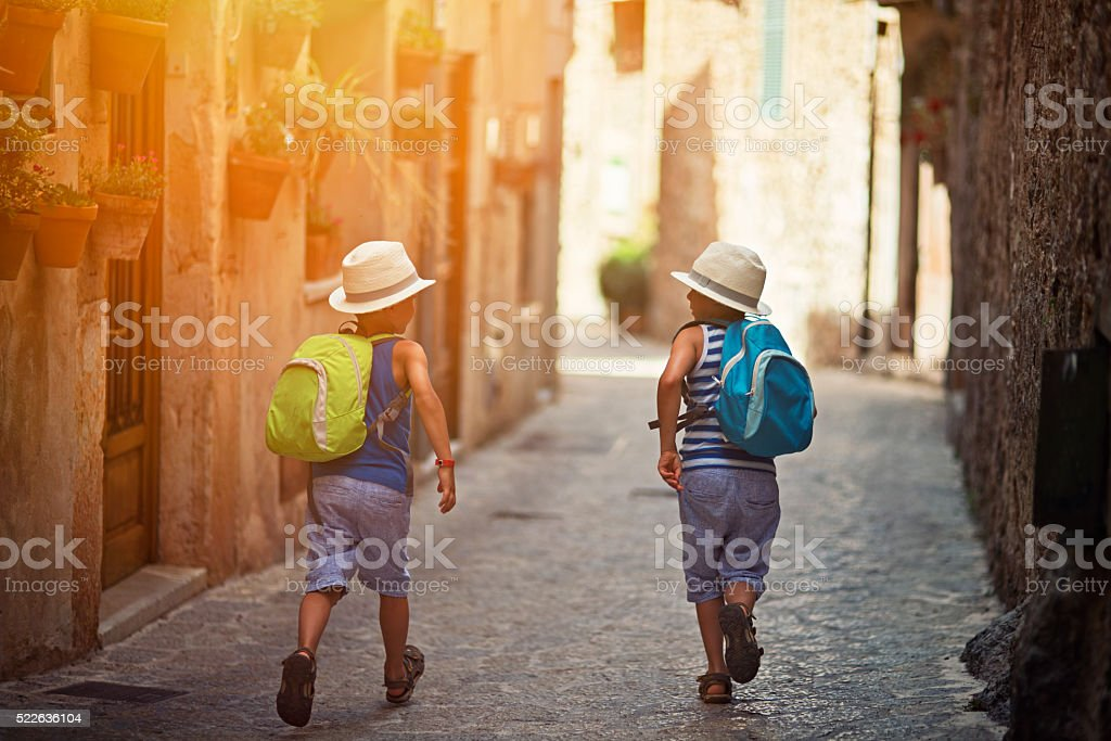 Kids running in mediterranean street. stock photo