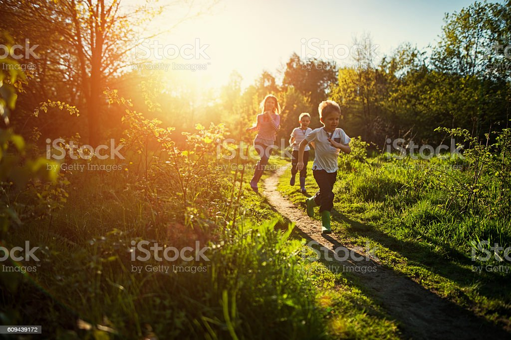 Kids running in nature. stock photo