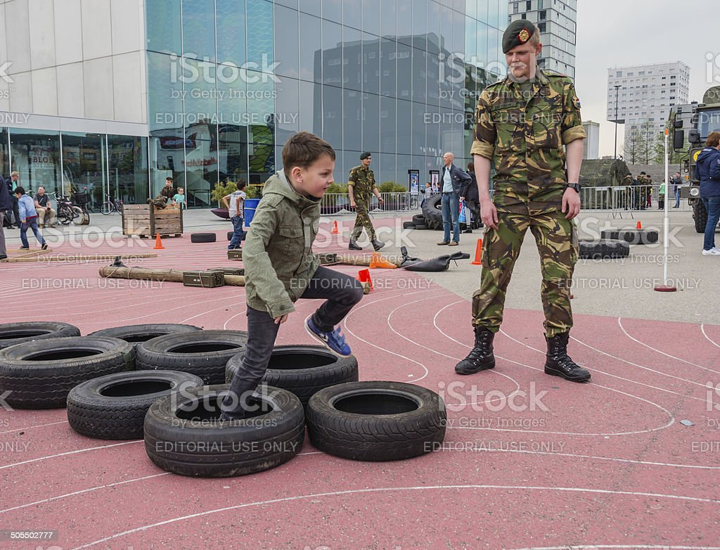 Kids running military obstacle course stock photo