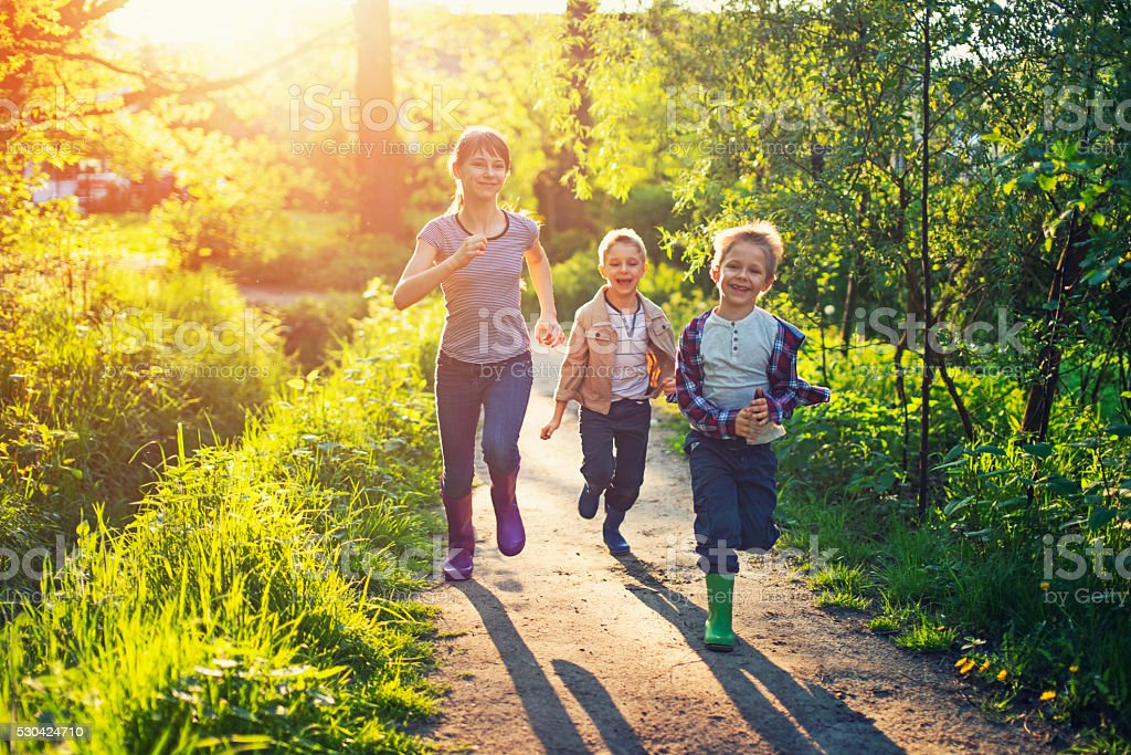 Kids running on a forest path. stock photo