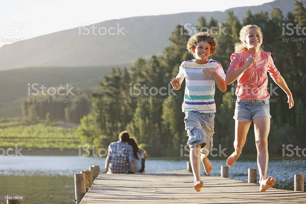 Kids running on dock royalty-free stock photo
