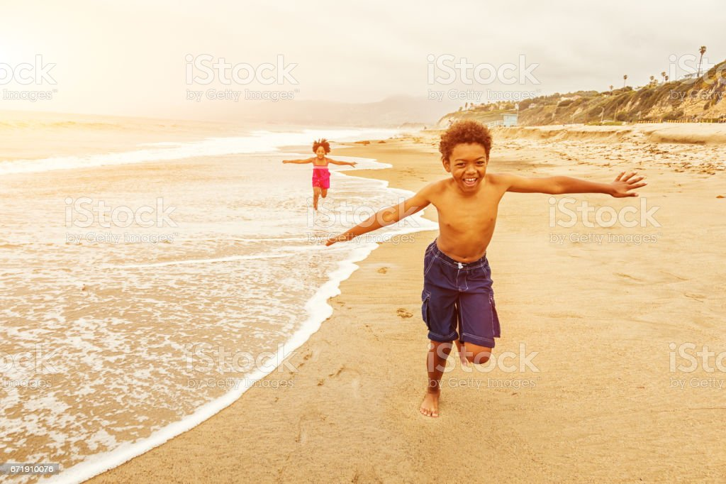 Kids Running on The Beach stock photo