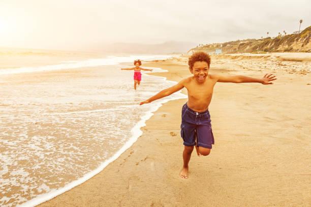 Kids Running on The Beach stock photo