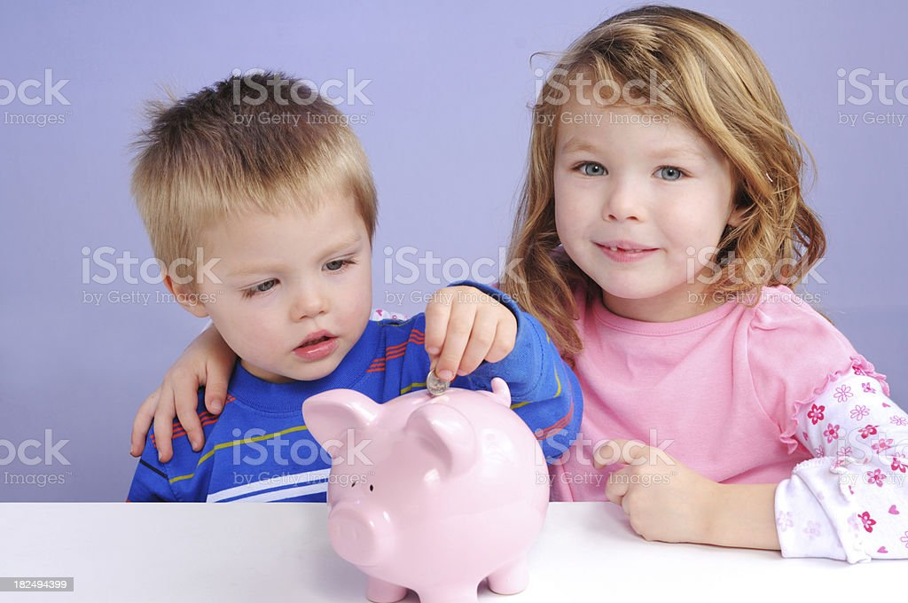Kids saving their nickel. royalty-free stock photo