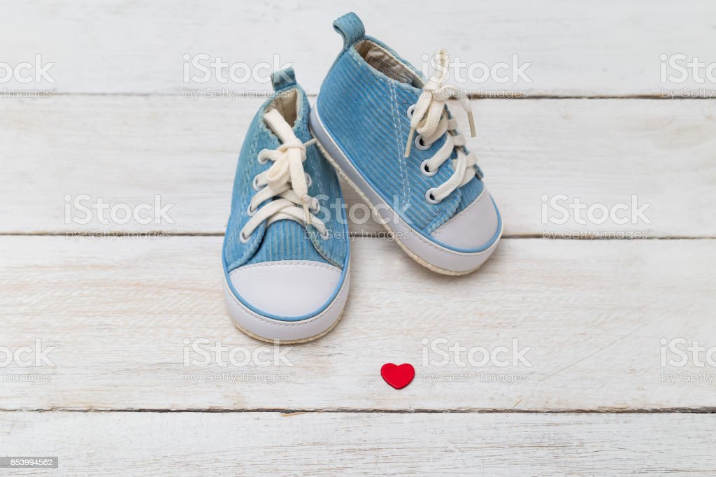 Kids shoes for a little boy with heart stock photo