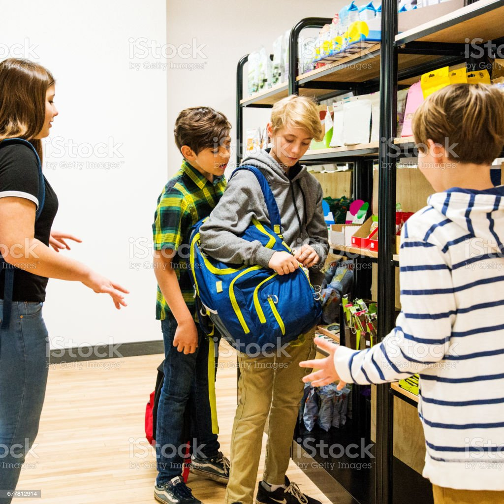 Kids shoplifting candy in a supermarket or convenience store royalty-free stock photo