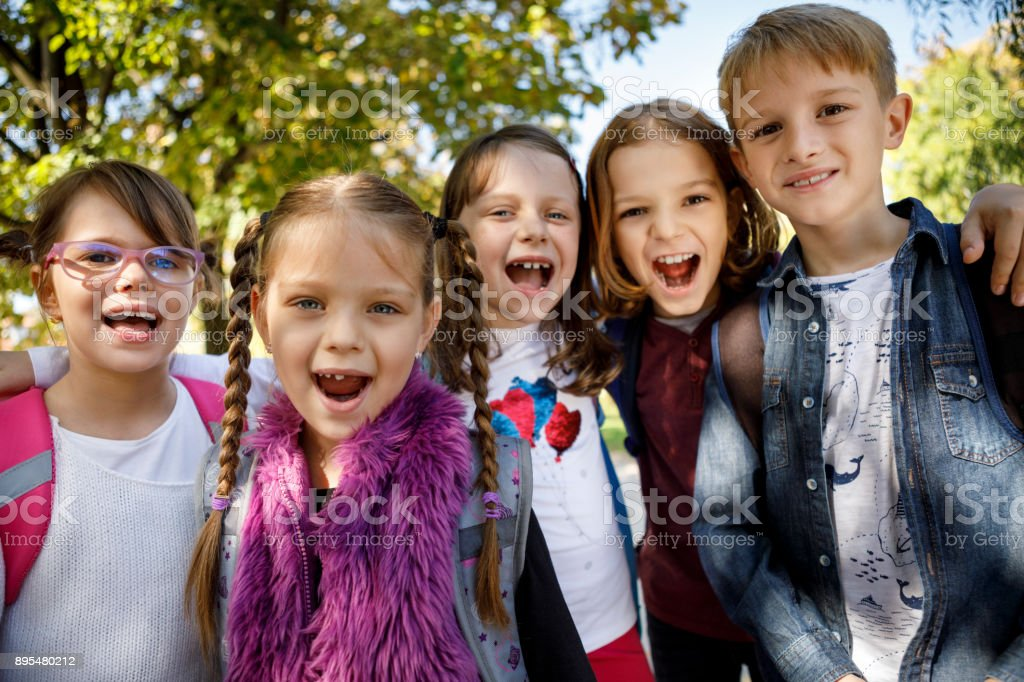 Kids shouting outdoors together stock photo