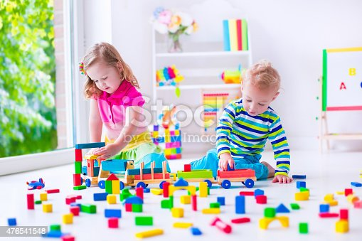 istock Kids siblings playing at day care 476541548