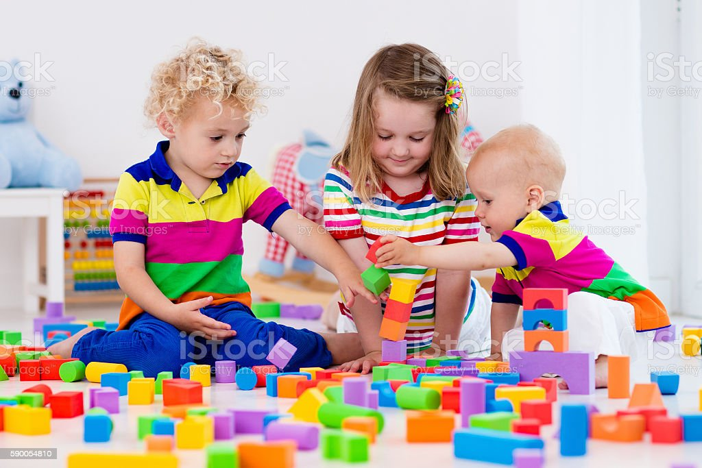 Toys For Siblings : Kids siblings playing with colorful toy blocks stock photo