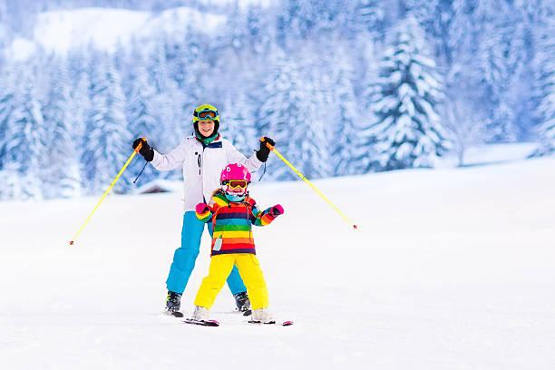 kids skiing in the mountains - winter austria train bildbanksfoton och bilder